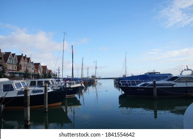 VOLENDAM, NETHERLANDS - DEC 11, 2018 - Fishing boats moored in the marina and waterfront of Volendam, Netherlands