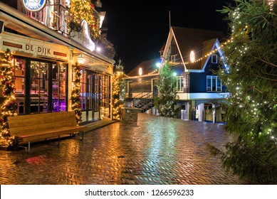 Volendam, Netherlands - December 31, 2018: Downtown of Volendam is decorated with Christmas illuminations on New Year's Eve