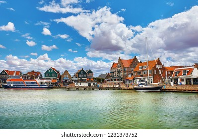 Volendam, Netherlands. High-speed motorboat by docks near old traditional town not far from Amsterdam. Famous touristic landmark with northern sea and sunny day with blue sky.