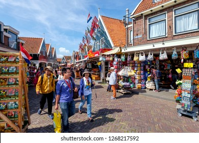 Volendam, Netherlands, July 2017. Asian tourists in the main street of Volendam with many souvenir shops