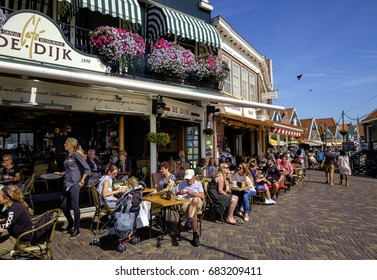 Volendam, Netherlands, July 2017. Tourists enjoying a drink in the sun at the terraces in the popular tourist destination of Volendam.