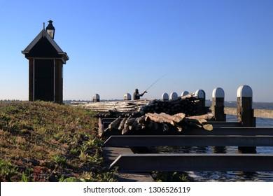 Volendam, Netherlands - JULY 30, 2018: Fisherman at the harbor of Volendam
