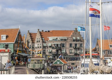 VOLENDAM, NETHERLANDS - JUNE 18, 2014: Boats and sail boats in Volendam Harbor. Volendam - a small town that has preserved the tradition of Dutch fishing villages.