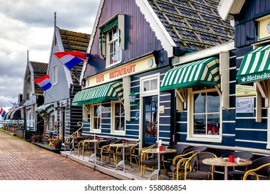 Volendam, Netherlands - June 30, 2016:  tourist restaurant on the pier in Volendam, cloudy spring day in Volendam fishing village north of Amsterdam.