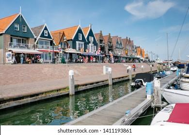 Volendam, Netherlands - May 14, 2019: typical Dutch lodges along the marina of Volendam