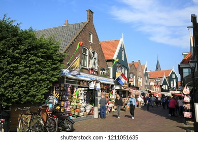 Volendam, The Netherlands - October 6, 2018: Street with gift shops in touristic village Volendam in the Netherlands