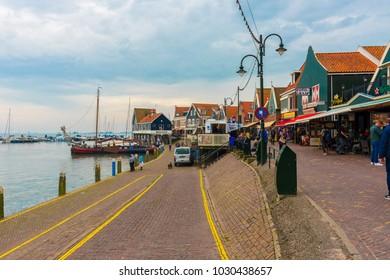 VOLENDAM, NETHERLANDS - SEPTEMBER 25, 2017: Volendam is a town in North Holland in the Netherlands. Colored houses of marine park in Volendam. North Holland, Netherlands.