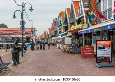 VOLENDAM, NETHERLANDS - SEPTEMBER 25, 2017: Volendam is a town in North Holland in the Netherlands. Colored houses of marine park in Volendam. North Holland, Netherlands.