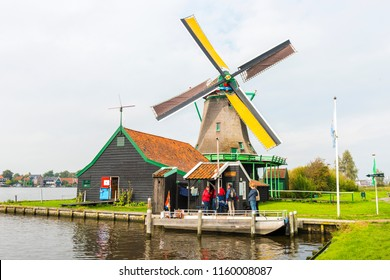 VOLENDAM, NETHERLANDS - SEPTEMBER 25, 2017: Windmills in Zaanse Schans. The Zaanse Schans is a typically Dutch small village in Amsterdam, Netherlands.