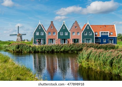 VOLENDAM, THE NETHERLANDS - September 3, 2016:  Coloured houses at the Marine Resort in Volendam on September 3, 2016, The Netherlands.