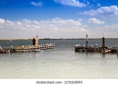 VOLENDAM,HOLLAND,NETHERLANDS -AUGUST 19, 2018:harbor entrance of the small harbor of Volendam, Markermeer, Holland, Netherlands