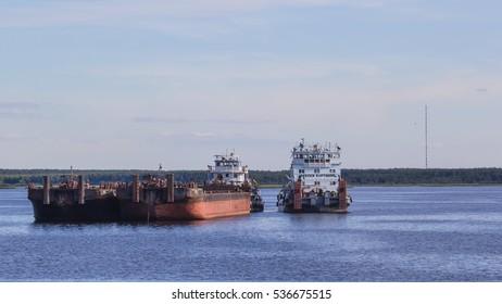 "VOLGA RIVER, RUSSIA - JUNE 29, 2016; Cargo river ships ""Alexander Lagutin"" and ""Aleksei Kartashov"""