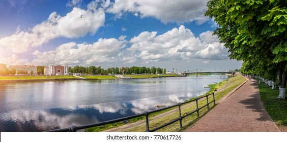 The Volga River in Tver under white clouds on a blue sky on a sunny summer day
