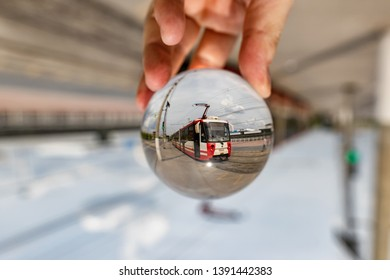 VOLGOGRAD - MAY 4: View of the Volgograd high-speed tram through a lensball. May 4, 2019 in Volgograd, Russia.