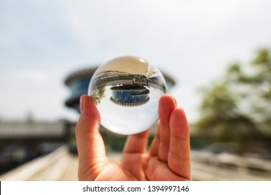 VOLGOGRAD - MAY 4: View on building of Volgograd river port in the form of a large washer of glass and concrete through lensball. May 4, 2019 in Volgograd, Russia.