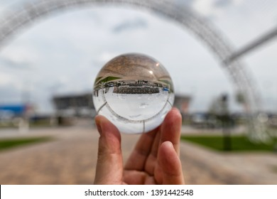 VOLGOGRAD - MAY 4: The view of the stadium Volgograd arena from the Park through lensball. May 4, 2019 in Volgograd, Russia.