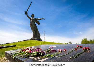 VOLGOGRAD - MAY 9: Flowers on the Mamayev Kurgan to World War II Memorial Motherland statue. May 9, 2014 in Volgograd, Russia.