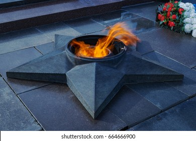 Volgograd, Russia - 12 June 2017: Eternal flame - symbol of victory in World War II with flowers, Square Of Fallen Fighters