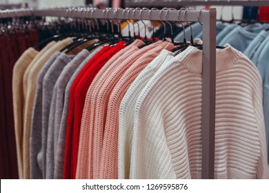 VOLGOGRAD, RUSSIA - 19 December, 2018:  Women's pink make look slender, olympic sweatshirts, sweaters hang on a hanger. Sale of clothes in shop