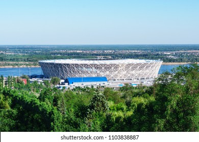 Volgograd, Russia - 27 May 2018: Top of the new football stadium Volgograd Arena. View from the great Russian complex of the monument Mamaev Kurgan. Bright fresh forest