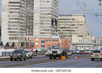 Volgograd, Russia - 28 December, 2018: Workers on the crane install and decorate the Astrakhan bridge with led light in Volgograd