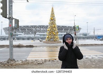 VOLGOGRAD, RUSSIA - 5 January, 2019: The woman in winter clothes walks near the central stadium, the district of the city of Volgograd