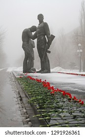 Volgograd, Russia - February 03, 2013: Red carnations assigned to the monument to Komsomol members in Volgograd. Event dedicated to the celebration of Victory Day in the battle of Stalingrad.