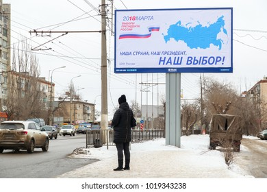 VOLGOGRAD, RUSSIA - January 29, 2018: A display the poster to March Russian presidential elections on the street in the winter