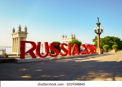 "VOLGOGRAD, RUSSIA - JULY 28, 2017: installation of the inscription ""Russia 2018"" on the central embankment of Volgograd in honor of the World Cup, which will be held in Russia in 2018."