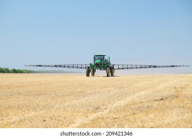 """Volgograd, Russia - JULY 31, 2014: Demonstration of agricultural machinery in the context of """"Field Days"""" -annual review of agricultural machinery, which took place on July 31, 2014, Volgograd, Russia"""