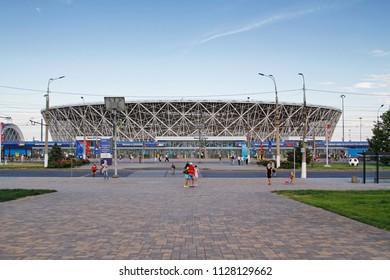 "Volgograd, Russia- June 25, 2018: People walk near the football stadium ""Volgograd-Arena"" for the world Cup in 2018 in Volgograd"