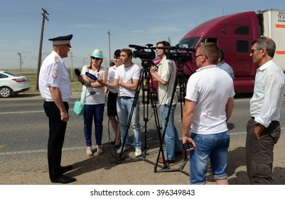 VOLGOGRAD, RUSSIA - JUNE 3, 2014: The officer of road patrol service gives interviews to journalists.