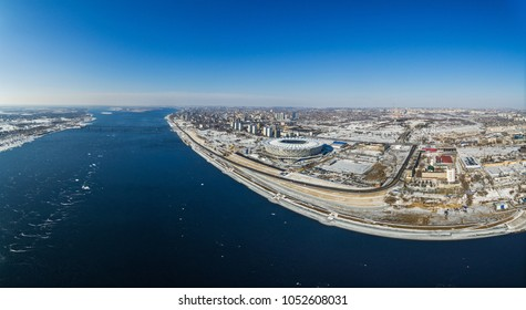 """Volgograd, Russia - March 23 2018. A aerial panoramic view of the Volga river: on the right hand - construction site of the football stadium """"Volgograd arena"""" for the FIFA World Cup 2018."""