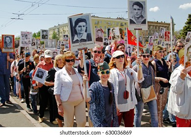 "Volgograd, Russia - May 09, 2016: People hold portraits of their relatives in the action ""Immortal regiment"" on Victory day in Volgograd"