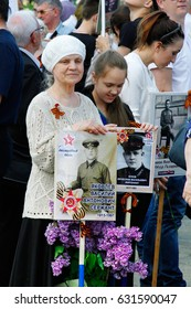 """Volgograd, Russia - May 09, 2016: People hold portraits of their relatives in the action """"Immortal regiment"""" on Victory day in Volgograd"""