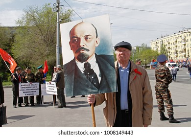 Volgograd, Russia - May 1, 2017: Old man with portrait of the Soviet founder Vladimir Lenin takes part in the May day demonstration in Volgograd