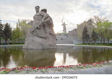 Volgograd, Russia - May 2, 2015: The Soldier monument  and The Motherland Calls beyond. It is a statue in Mamayev Kurgan, commemorating the Battle of Stalingrad.