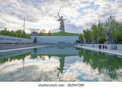Volgograd, Russia - May 2, 2015: The Motherland Calls monument with its reflection in lake. It is a statue in Mamayev Kurgan, commemorating the Battle of Stalingrad.