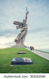 Volgograd, Russia - May 2, 2015: The Motherland Calls monument and carnation flowers on memorial in the foreground. It is a statue in Mamayev Kurgan, commemorating the Battle of Stalingrad.