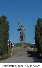 "Volgograd, Russia - May 9, 2018: Avenue poplars. Memorial complex Mamayev Kurgan in Volgograd. Memorial complex ""Heroes of the Battle of Stalingrad"" in Volgograd , Russia. The Motherland calls!"