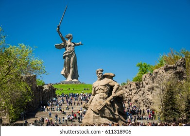 VOLGOGRAD, RUSSIA - MAY 9: People rises up the stairs on the Mamayev Kurgan to World War II Memorial Motherland statue in the victory day May 9, 2014 in Volgograd, Russia.