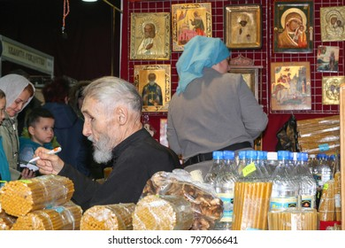 "VOLGOGRAD, RUSSIA - November 25, 2017: Sale of church things, utensils with sellers the old man and the woman and buyers at the festival ""Be Enough Christmas!"" in Expocentre"