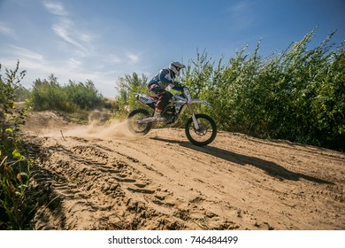 Volgograd, Russia - OCTOBER 03,2015: Island offroad,the championship of the region,unknown racer in the food at high speed during a race