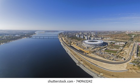 "Volgograd, Russia - October 09 2017. A panoramic view of the Volga river: on the right hand - construction site of the football stadium ""Volgograd arena"" for the FIFA World Cup 2018."