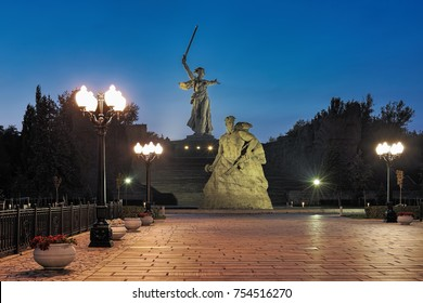 """VOLGOGRAD, RUSSIA - OCTOBER 18, 2017: Evening view of Mamayev Kurgan with memorial complex commemorating the Battle of Stalingrad. The huge statue """"The Motherland Calls!"""" is located on top of the hill"""