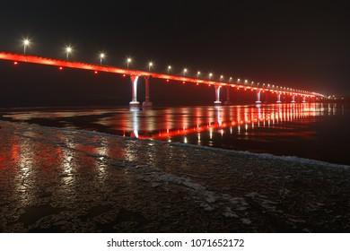 Volgograd, Russia. Red illumination of the bridge over the Volga river