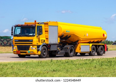 VOLKEL, THE NETHERLANDS - JUN 15, 2013: Mobile kerosine refueling vehicle driving on the taxi track of Volkel airbase