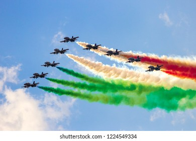 VOLKEL, THE NETHERLANDS - JUN 15, 2013: The Italian aerobatic demonstration team Frecce Tricolori performing with their MB339 jet aircraft at the Dutch Air Force Open Day airshow.
