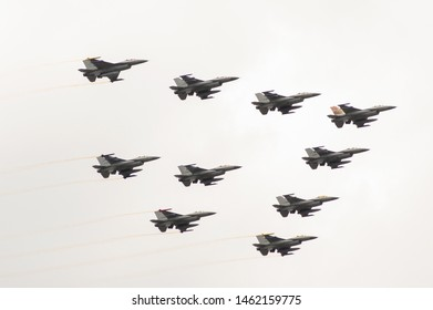 Volkel, Netherlands - June 14, 2019: Air power demo, dutch F-16's flying in formation  during an airshow