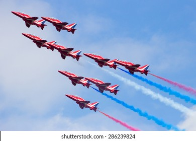 VOLKEL, NETHERLANDS - JUNE 15, 2013: RAF airshow demonstration team Red Arrows performing at the Dutch Air Force Open Days. The Red Arrows have performed over 4,600 displays in 56 countries worldwide.